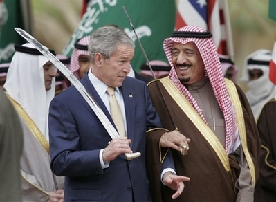 President Bush stands with Saudi Prince Salman, right, brother of Saudi King Abdullah, while watching a traditional sword dance at the Al Murabba Palace and Natural History Museum in Al Janadriyah, Saudi Arabia, Tuesday, Jan. 15, 2008. (AP Photo/Susan Walsh)